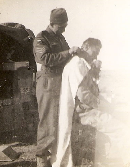 British soldier receives haircut in N. African desert, 1941