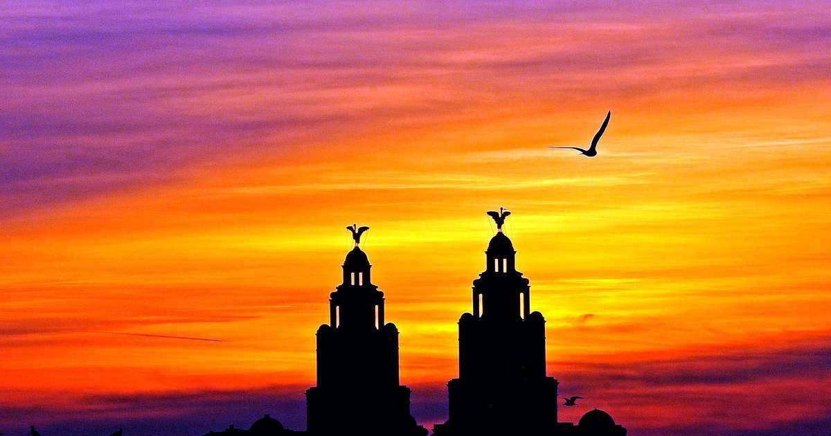 Sunset over the twin Liver birds on Liverpool's Liver Building. Courtesy Liverpool Echo