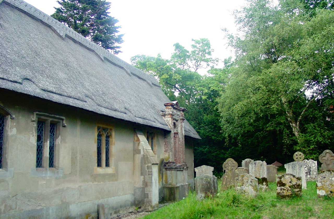 Side view of Ringsfield parish church, Suffolk, showing graves