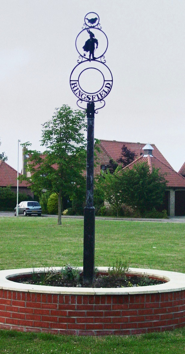 Picture showing modern Ringsfield village green and sign
